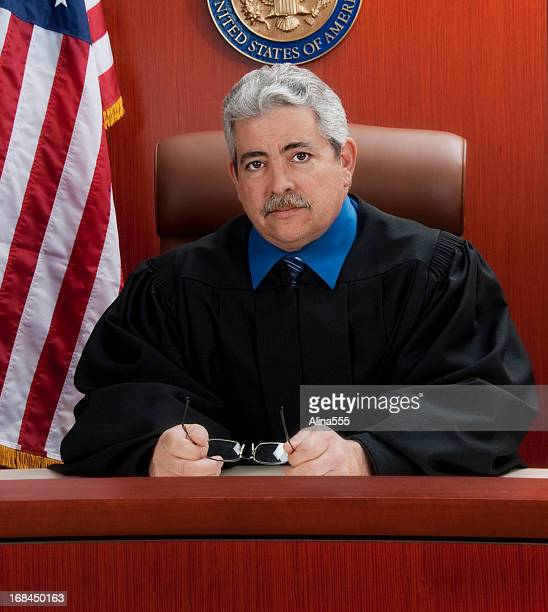 Mature judge at the bench with a serious look
