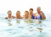 Mature ladies laughing on beach