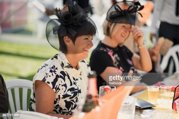 mature ladies on race day - fascinator stock pictures, royalty-free photos & images
