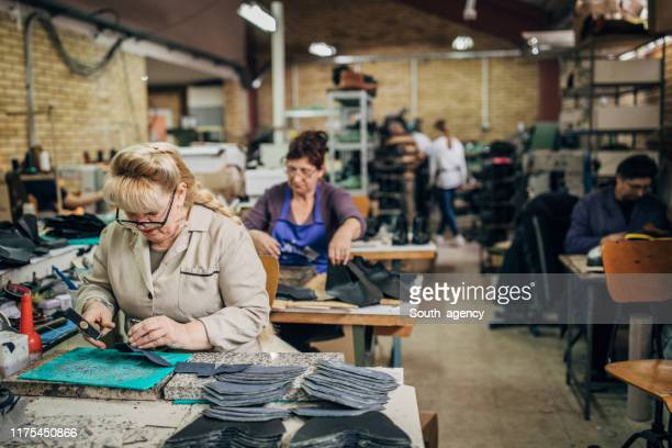 mature ladies working at shoe factory - shoe factory stock pictures, royalty-free photos & images