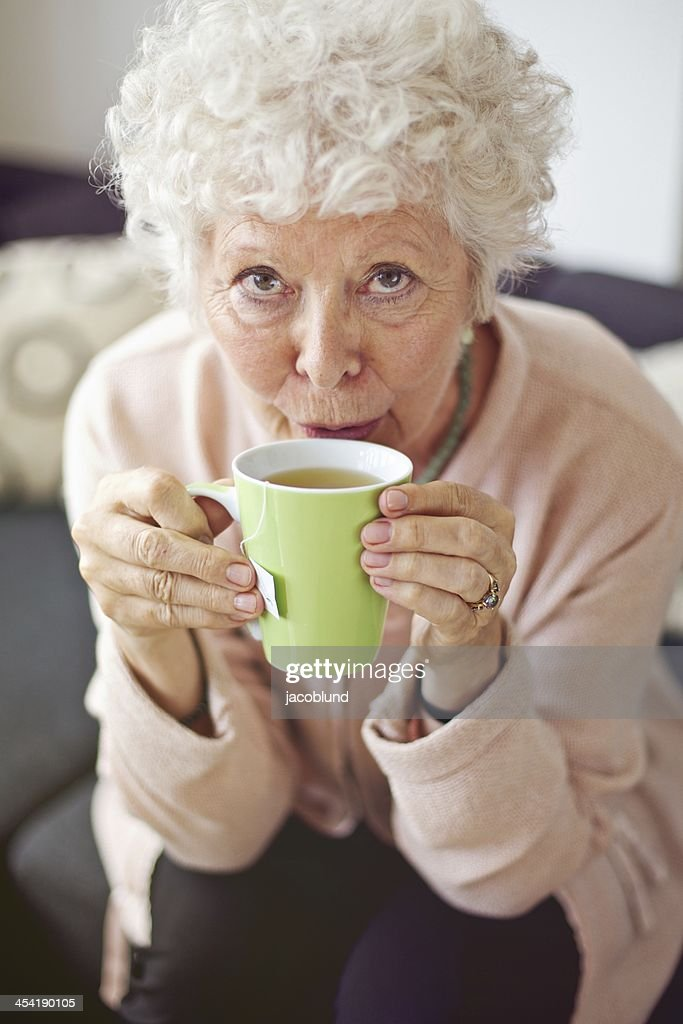 Mature Lady at Home Drinking Tea : Stock Photo