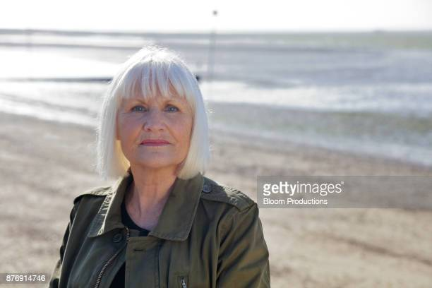 mature lady at the beach - bangs stock photos and pictures
