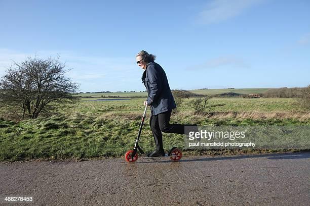 Mature lady enjoying scooter ride