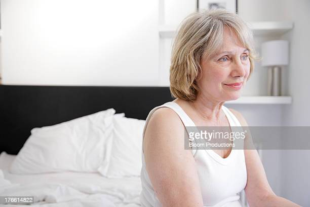 mature lady in a bedroom - sleeveless stock pictures, royalty-free photos & images
