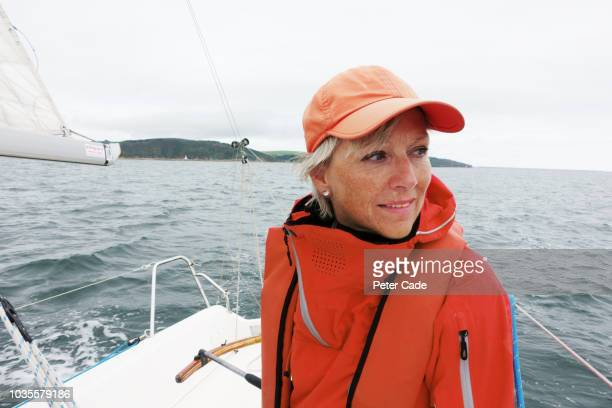 mature lady on sailing boat - coat stock pictures, royalty-free photos & images