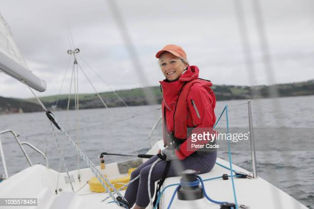mature lady sailing boat - yachting stock pictures, royalty-free photos & images
