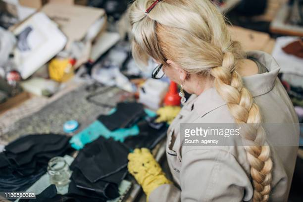 mature lady working at shoe factory - leather glove stock pictures, royalty-free photos & images
