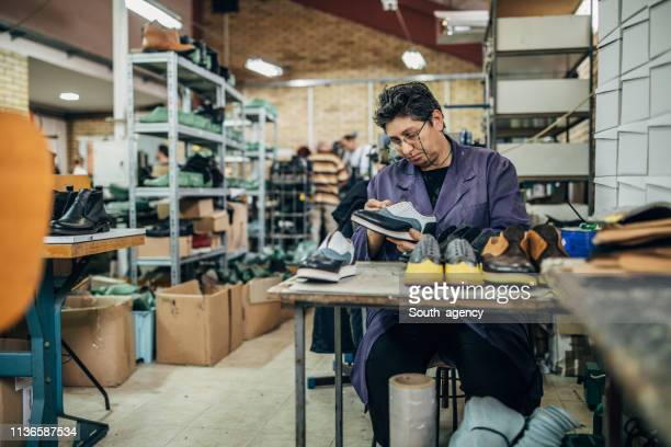 mature lady working at shoe factory - shoe factory stock pictures, royalty-free photos & images