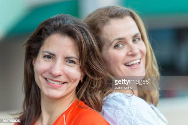 Mature lesbian women posing together smiling