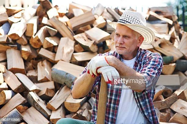 Mature lumberjack resting after splitting wood. Debica, Poland
