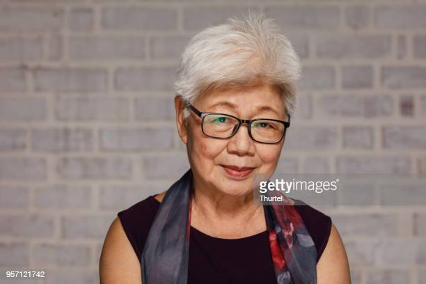 mature malaysian woman - east asian culture stock photos and pictures