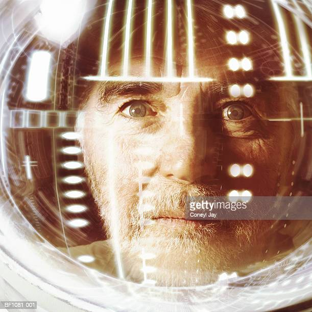 Mature male astronaut, relflections in visor, portrait, close-up