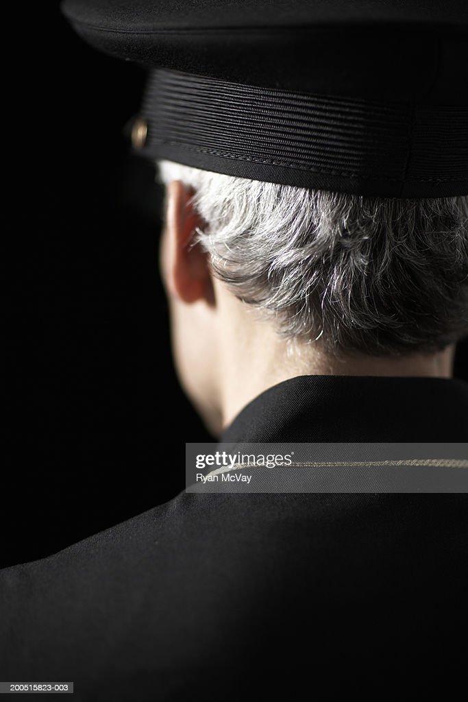 Mature male bellhop wearing uniform, rear view : Foto de stock
