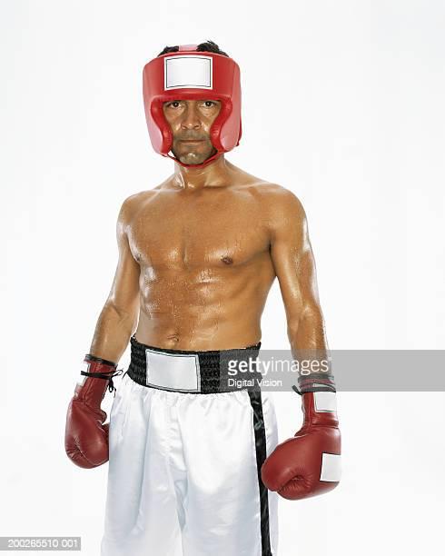 Mature male boxer wearing head protection, portrait