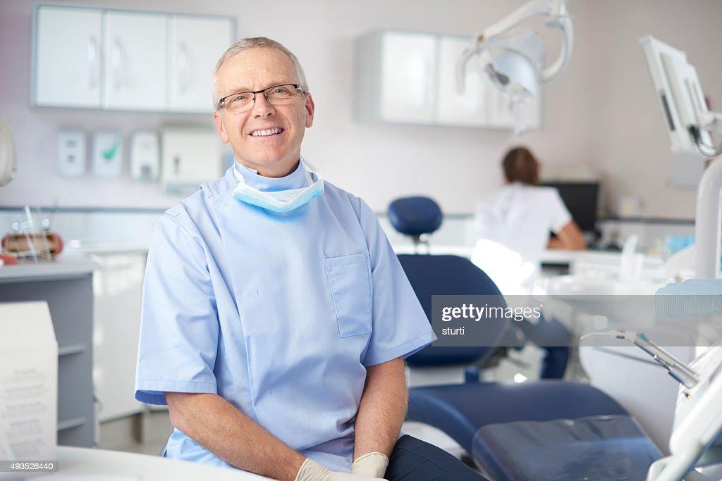 mature male dentist portrait : Stock Photo
