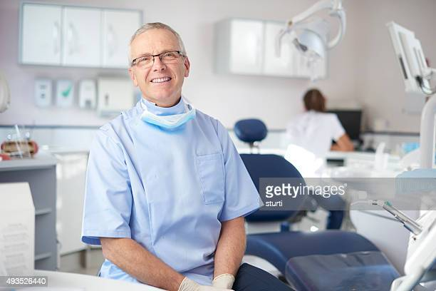 mature male dentist portrait