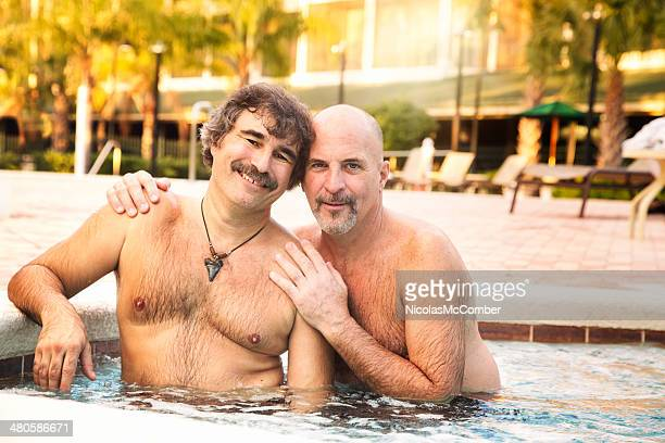 Mature male gay hairy couple in hot tub