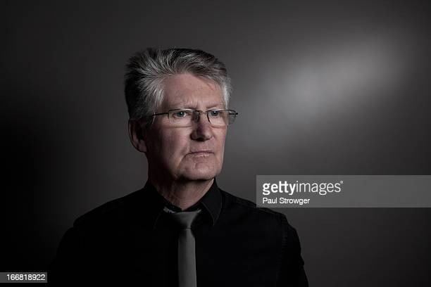 Mature Male in Black Shirt on Grey
