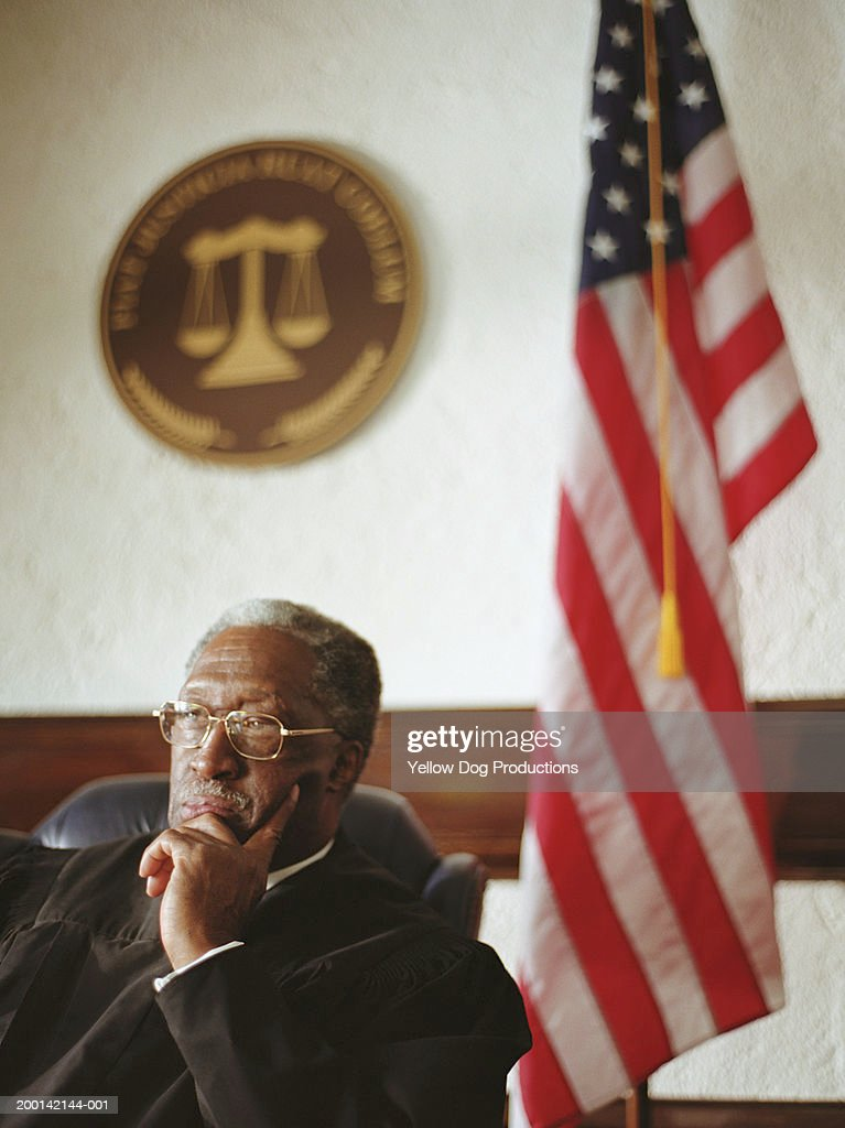 Mature male judge in courtroom : Stock Photo
