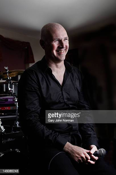 mature male lead singer resting before performance - lead singer stock pictures, royalty-free photos & images
