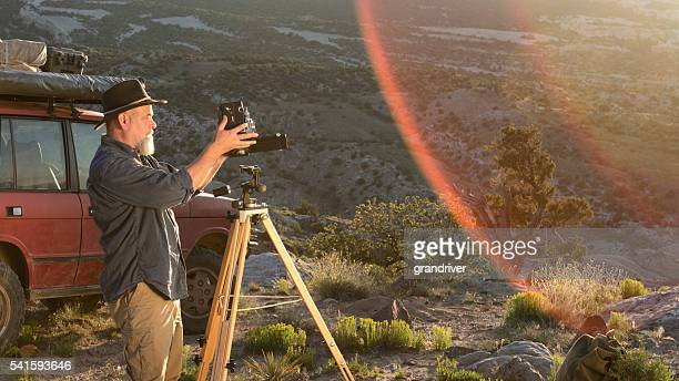 mature male photographer with medium format camera - photographic film camera stock photos and pictures