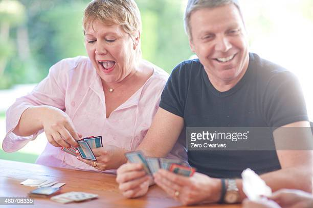 Mature male playing cards with sister