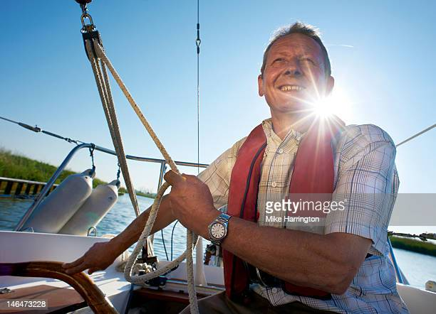 Mature Male Sailing on Yacht
