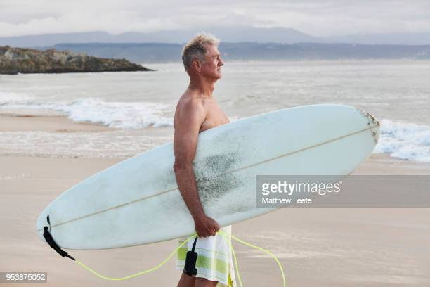 Mature male surfer at beach