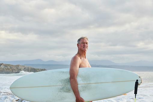 Mature male surfer at beach - gettyimageskorea