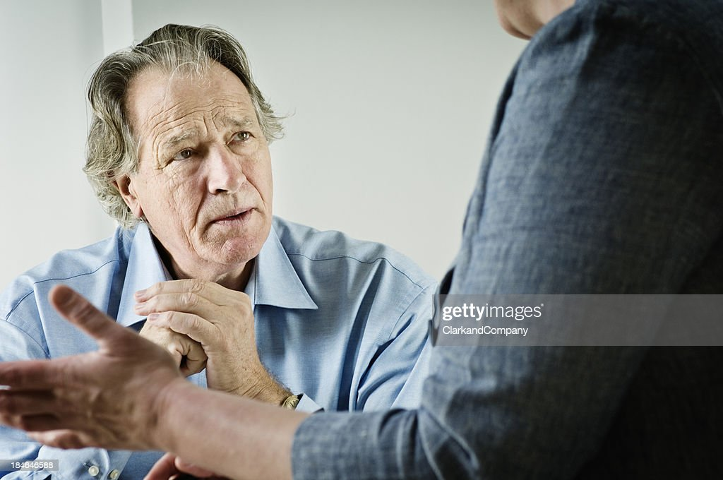 Mature Male talking To a Counsellor : Stock Photo