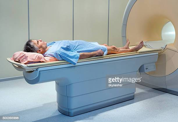 mature man about to receive mri scan. - pet scan machine stock pictures, royalty-free photos & images
