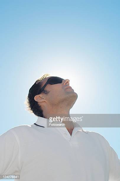 Mature man against clear sky (low angle view)