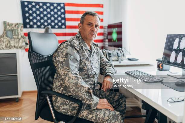 mature man american soldier in office - us navy stock pictures, royalty-free photos & images