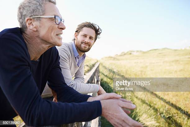 Mature man and adult son at the coast