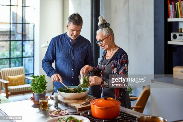mature man and senior woman making lunch - {{ collectponotification.cta }} stock pictures, royalty-free photos & images