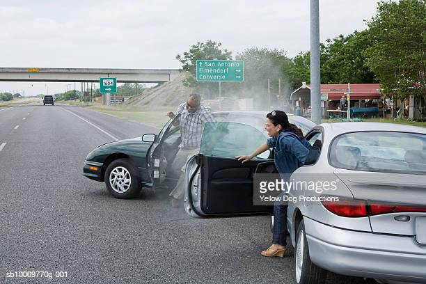 mature man and woman getting out of car after accident - getting out stock pictures, royalty-free photos & images