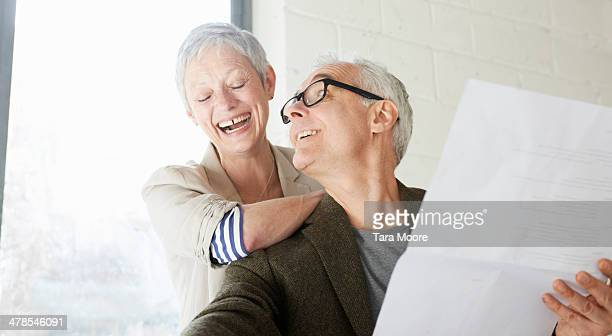 mature man and woman in office