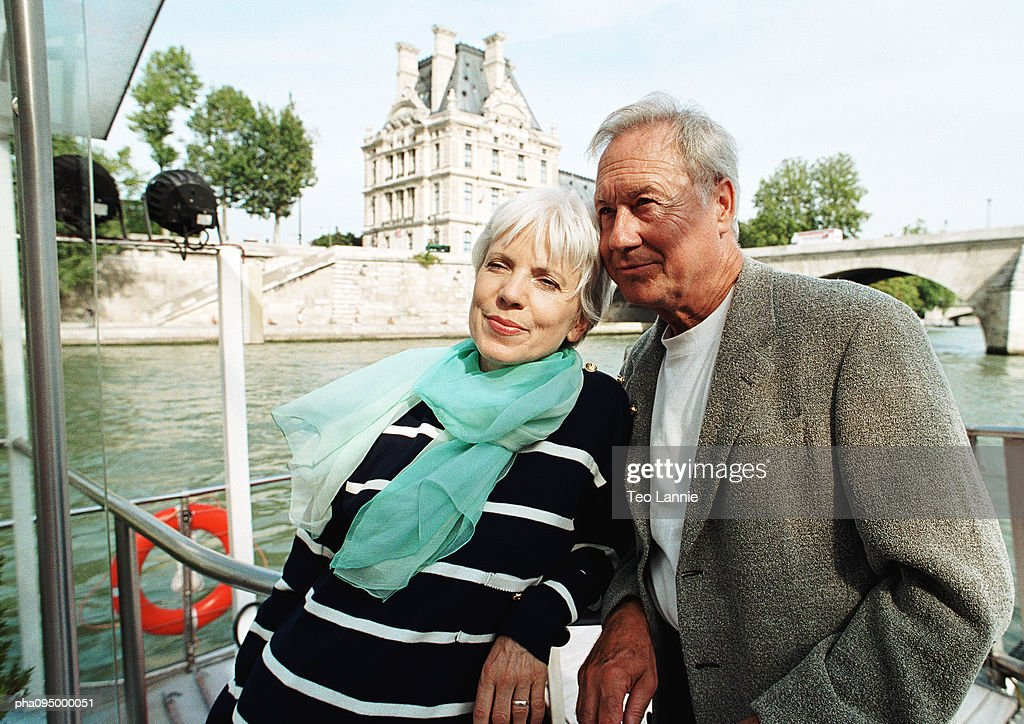 Mature man and woman on a barge : Stockfoto