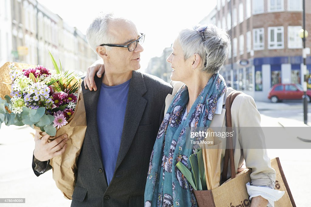 mature man and woman on street with shopping : Stock Photo