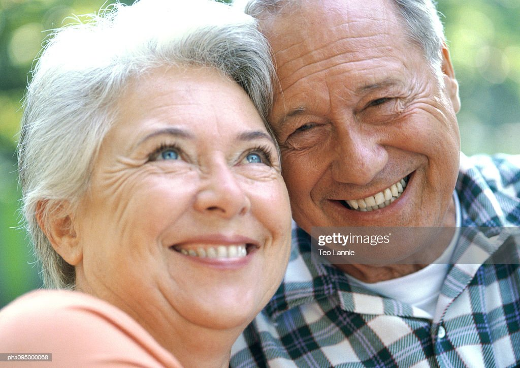 Mature man and woman smiling, close-up,  portrait : Stockfoto