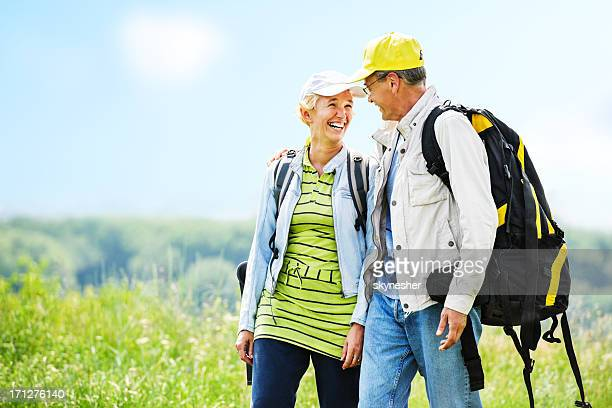 Mature man and woman tourists enjoying in the park.