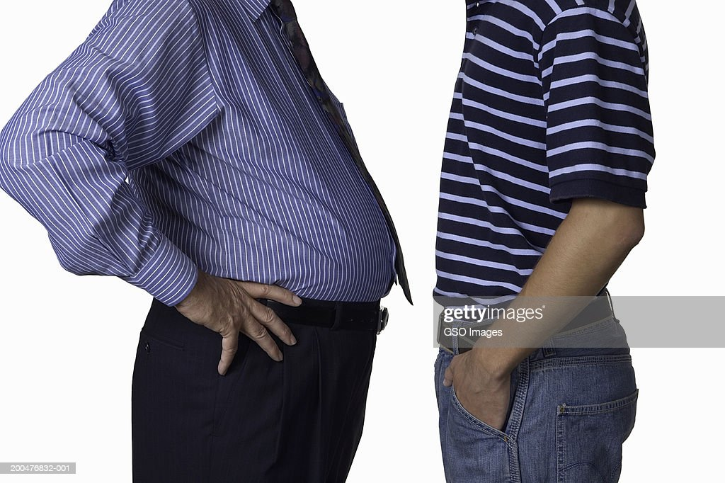 Mature man and young man, mid section, side view : Stock Photo