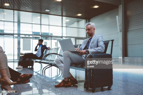 Mature man at airport lounge waiting for his flight