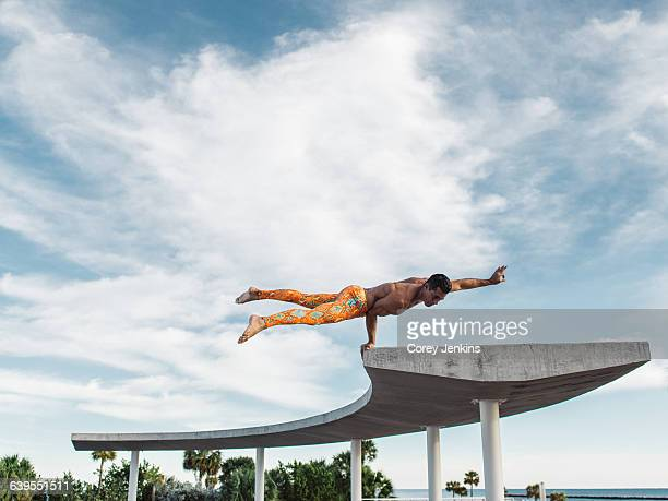 mature man balancing on structure, south pointe park, south beach, miami, florida, usa - miami beach south pointe park stock pictures, royalty-free photos & images