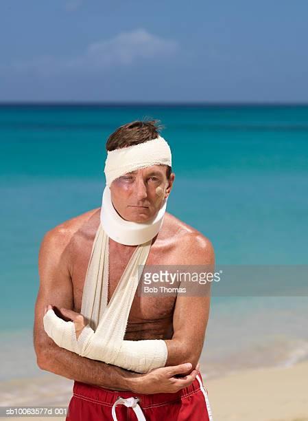 Mature Man Bandaged on Beach, Portrait