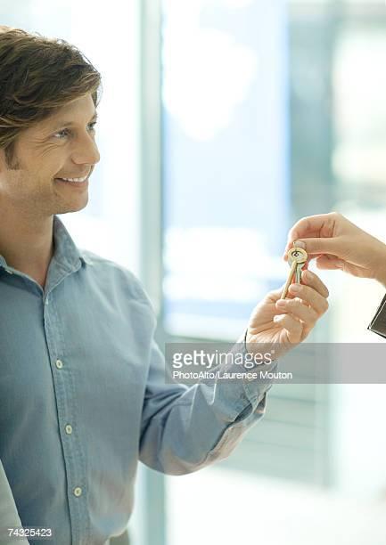 Mature man being handed set of keys