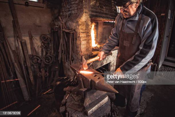 mature man blacksmith at work in his metalworking shop,nieuwkoop,netherlands - images stock pictures, royalty-free photos & images