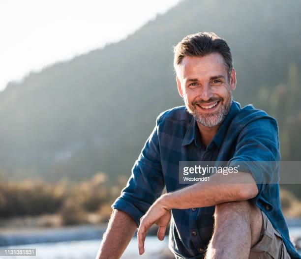 mature man camping at riverside - 45 49 jahre stock-fotos und bilder