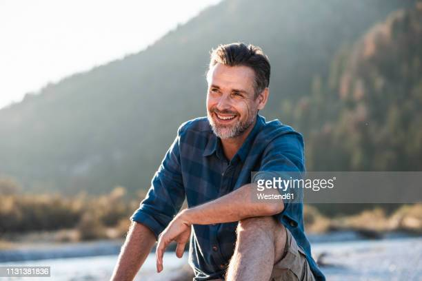 mature man camping at riverside - mature men stock pictures, royalty-free photos & images