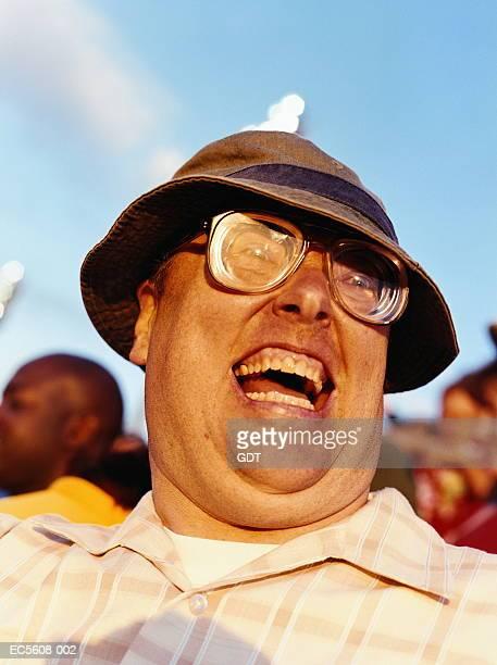 Mature man cheering in stadium
